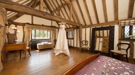 Cain Manor bridal suite with hanging wedding dress