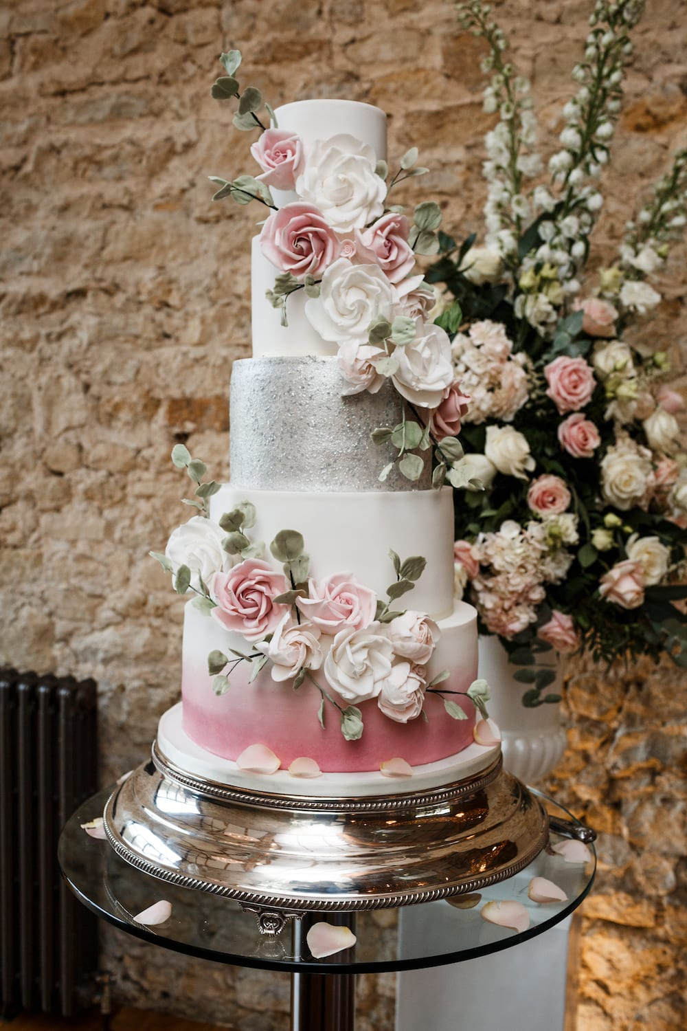 luxury tiered silver wedding cake with pink rose detailing