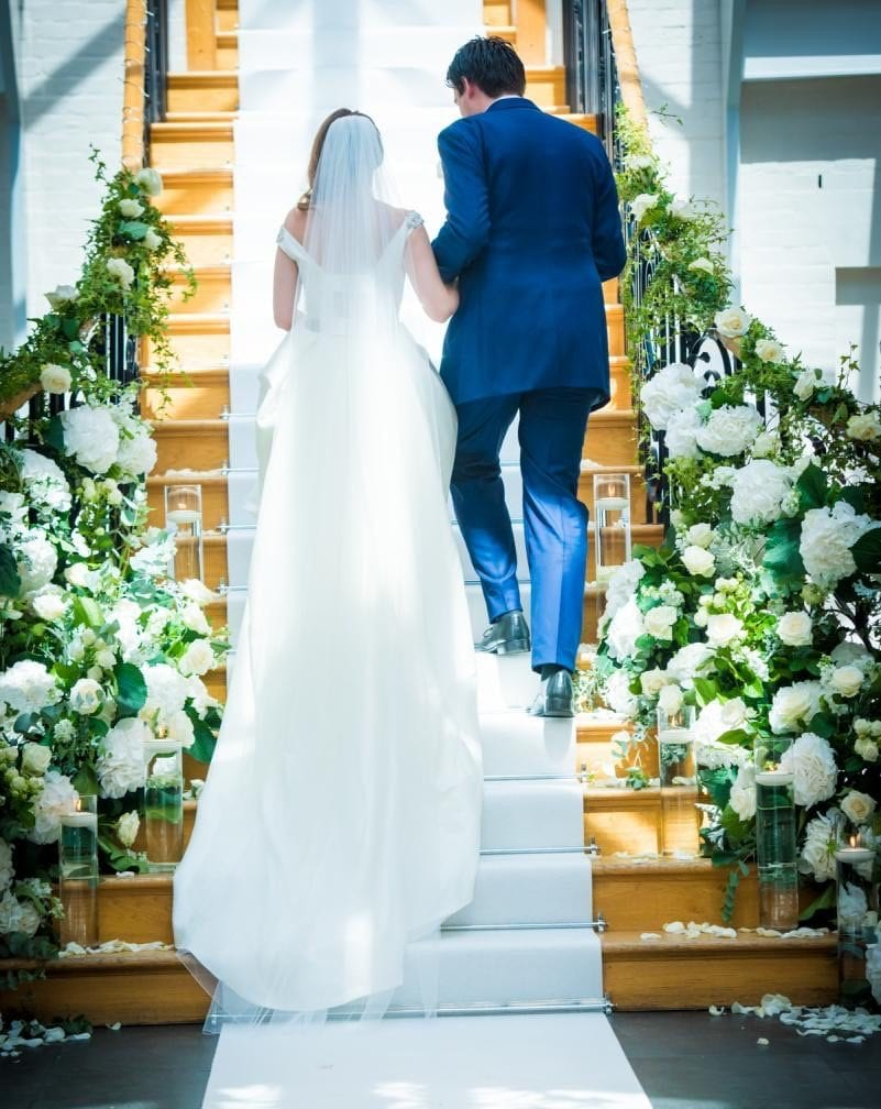 grand stair case flowers Bride Groom