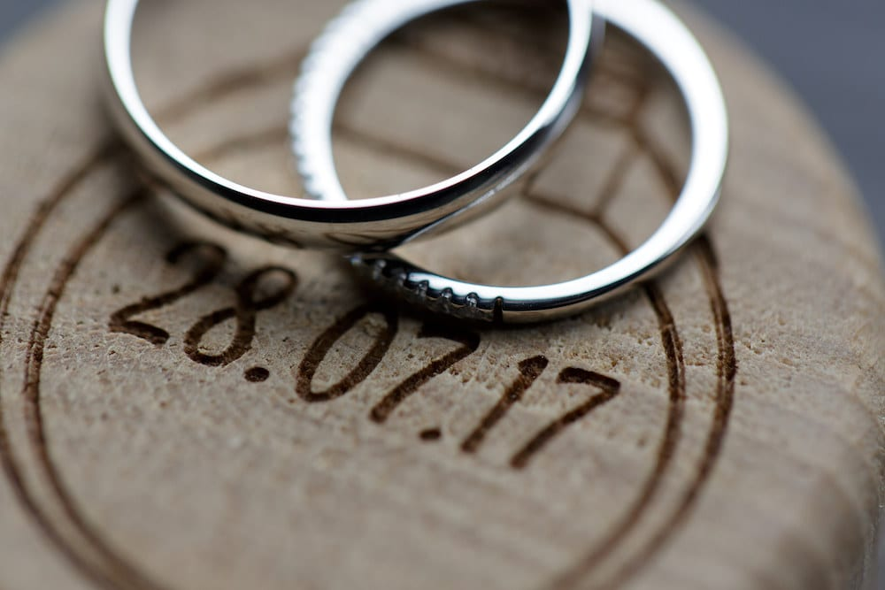 July wedding rings close up details