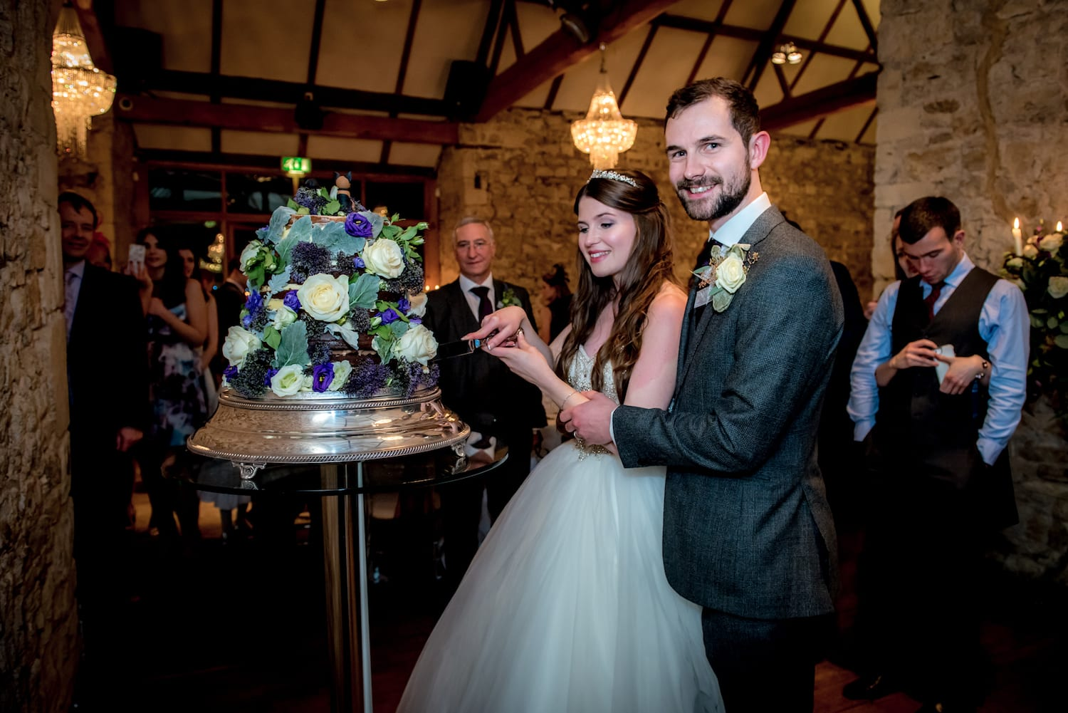 Notley Abbey tiered floral wedding cake cutting