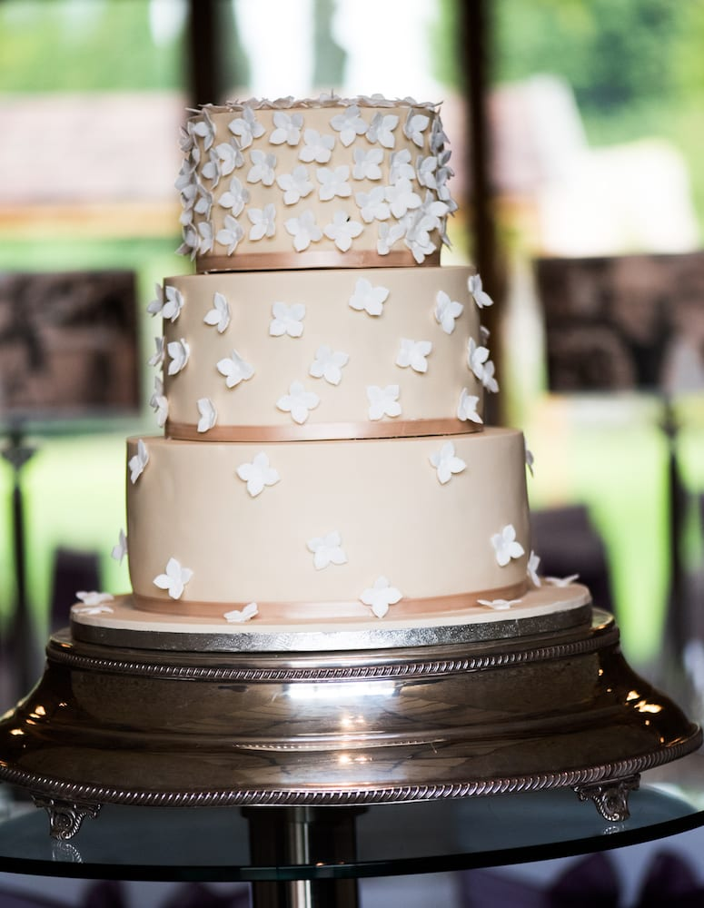 three tiered wedding cake with white detailing