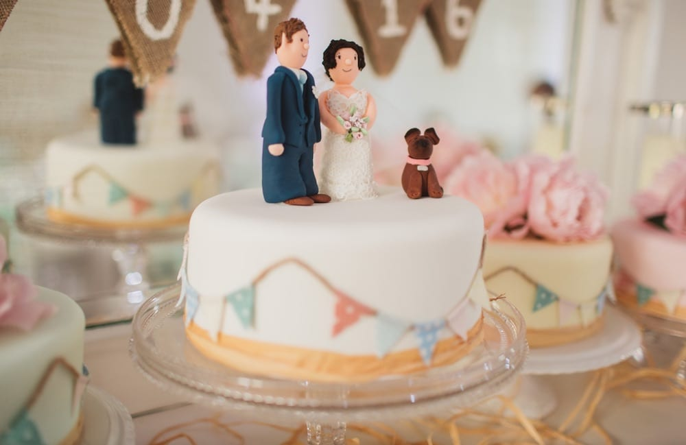 single tier wedding cake with personalised cake topper of dog