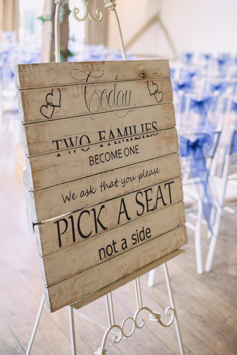 Cain Manor pick a seat sign